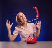 Big phone is screaming to woman Stock Photography