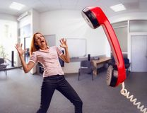 Big phone is screaming to woman Royalty Free Stock Photos