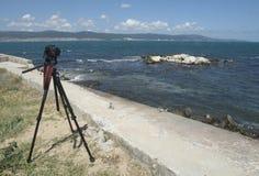 Big photocamera on beach of blue sea beach. Exotic Panorama Seaview wiht Big photocamera on beach of blue sea beach Stock Image