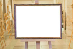 Big picture frame on easel in art gallery Royalty Free Stock Image