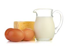 Big piece of cheese, glass jug with milk Stock Photo