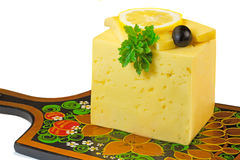 Big piece of cheese, lemon and olives on a white background. Royalty Free Stock Image