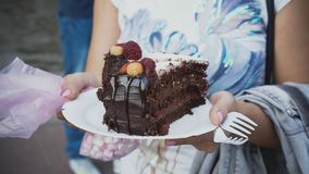 A big piece of chocolate cake at a street food festival stock image