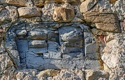Big piece of a cracked slate in an old stone wall Royalty Free Stock Image