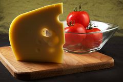 Big piece of fragrant elite cheese and tomatoes Royalty Free Stock Images