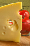 Big piece of fragrant elite cheese and tomatoes Royalty Free Stock Image