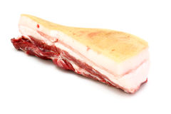The big piece of fresh fat. With a meat layer on a white background Stock Image
