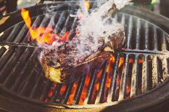 Flank Steak On Grill. A big piece of meat marbled beef on fire. Flank Steak On Grill stock images