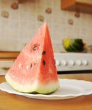 Big piece of ripe watermelon on the plate Royalty Free Stock Photography