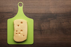 Big pieces of cheese on the cutting board Royalty Free Stock Photography