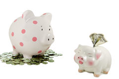 Big piggybank stares at small piggybank with $100 Stock Photography