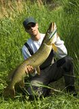 Big Pike. Man showing hes big pike catch Stock Photography