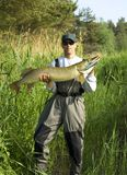 Big pike. Man showing the catch a big pike Stock Images