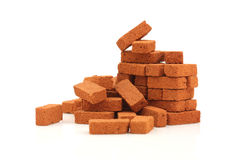 Big pile of bricks isolated. On white stock photography