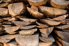 Big pile of brown planking made from trees settled at the yard in the village. In Ukraine stock image