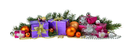 Big pile of Christmas gifts, tree branches, balls and beads. Royalty Free Stock Images