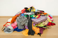 Big pile of clothes and accessories thrown on the ground. Royalty Free Stock Photography