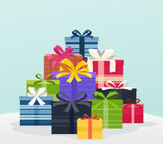 Big pile of colorful gifts with bows. Stock Photos