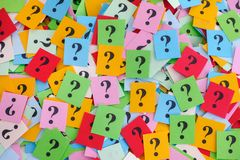 Big pile of colorful paper notes with question marks. Too Many Questions. Big pile of colorful paper notes with question marks. Closeup royalty free stock photos