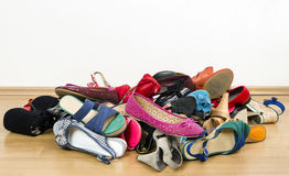 Big pile of colorful woman shoes. Royalty Free Stock Photos