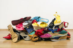 Big pile of colorful woman shoes. Stock Image