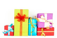 Big pile of colorful wrapped gift boxes isolated on white background. Mountain gifts. Beautiful present box with Royalty Free Stock Photography