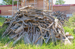 Big pile of construction waste from wood chips and boards Stock Images