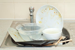 Big pile of dirty dishes Royalty Free Stock Images