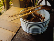 Big pile of finished Thai noodles left on the table. Concept of full stomache Stock Images