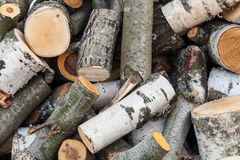 Big pile of firewood, aspen and birch chocks Royalty Free Stock Images