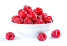 Big Pile of Fresh Raspberries in the White Bowl Isolated on White Background. Big Pile of Fresh Raspberries in the White Bowl Isolated on the White Background Royalty Free Stock Photo