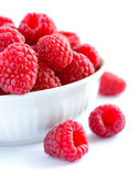 Big Pile of Fresh Raspberries in the White Bowl Isolated on White Background Royalty Free Stock Photo