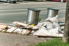 Big pile of junk and garbage dumped in the nature or park in the city polluting the environment with bad smell. Big pile of garbage and junk dumped on the street royalty free stock photo