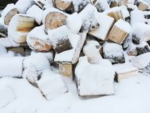A lot of logs, firewood littered with snow royalty free stock photography