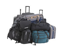 Big Pile of Luggage Isolated. Large pile of suitcases, luggage, bags and backpacks isolated Royalty Free Stock Image