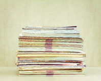 A big pile of magazines closeup, front view royalty free stock photography
