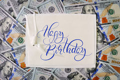 Big pile of money. stack american dollars backgrounds with text Happy Birthday. Calligraphy lettering Stock Photos