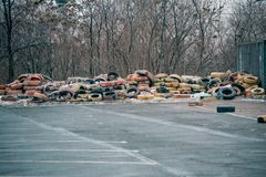 Big pile of old abandoned tires for wheels. Old rubber garbage royalty free stock images