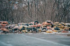Big pile of old abandoned tires for wheels stock photo