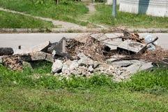 Big pile of old asphalt road debris damaged piling up on the ground royalty free stock photo