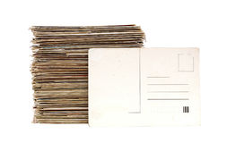 Big pile of old letters and postcards. With blank postcard for your text Royalty Free Stock Photography