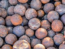 Big pile of an old rusty cannonballs Stock Images