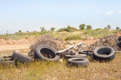 Big pile of old tires. Damage to the environment in a sunny day royalty free stock image