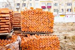 Big pile of orange bricks. Lies figure, texture, repair, construction, build a house, building, industry stock image
