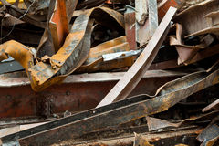 Big Pile Rusty Scrap Steel Girders Demolition Site. Pile of twisted and rusty scrap steel girders ready to be recycled at a building demolition site Royalty Free Stock Photos