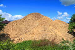 Big pile of sawdust in a sawmill Stock Photos
