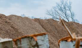 Big pile of wood shavings and wood mulch royalty free stock photos