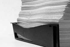 Big pile of work to be done. A large pile of white paper in a black business in tray indicating that lots of work needs to be done Stock Photos