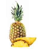 Big pineapple and slices Stock Photos