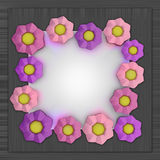 Big pink blossom square frame on metallic surface Royalty Free Stock Photo